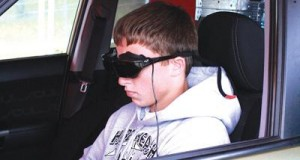 Jacob Butterfield takes his turn wearing the goggles.