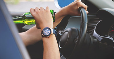 drinking-while-driving-wearing-watch