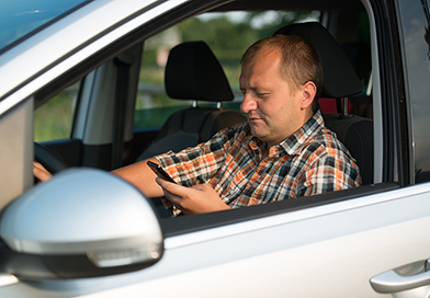texting-while-driving-middle-age-man