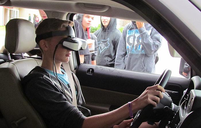 students-watch-driving-simulator