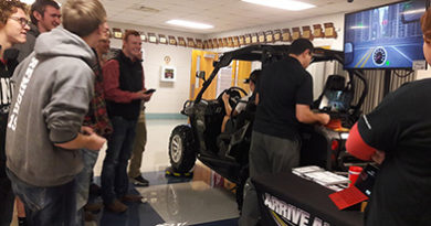 students-gather-round-distracted-driving-simulator