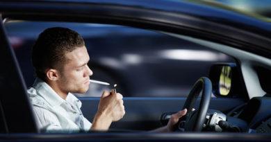 drugged-driving-man-smoking-marijuana